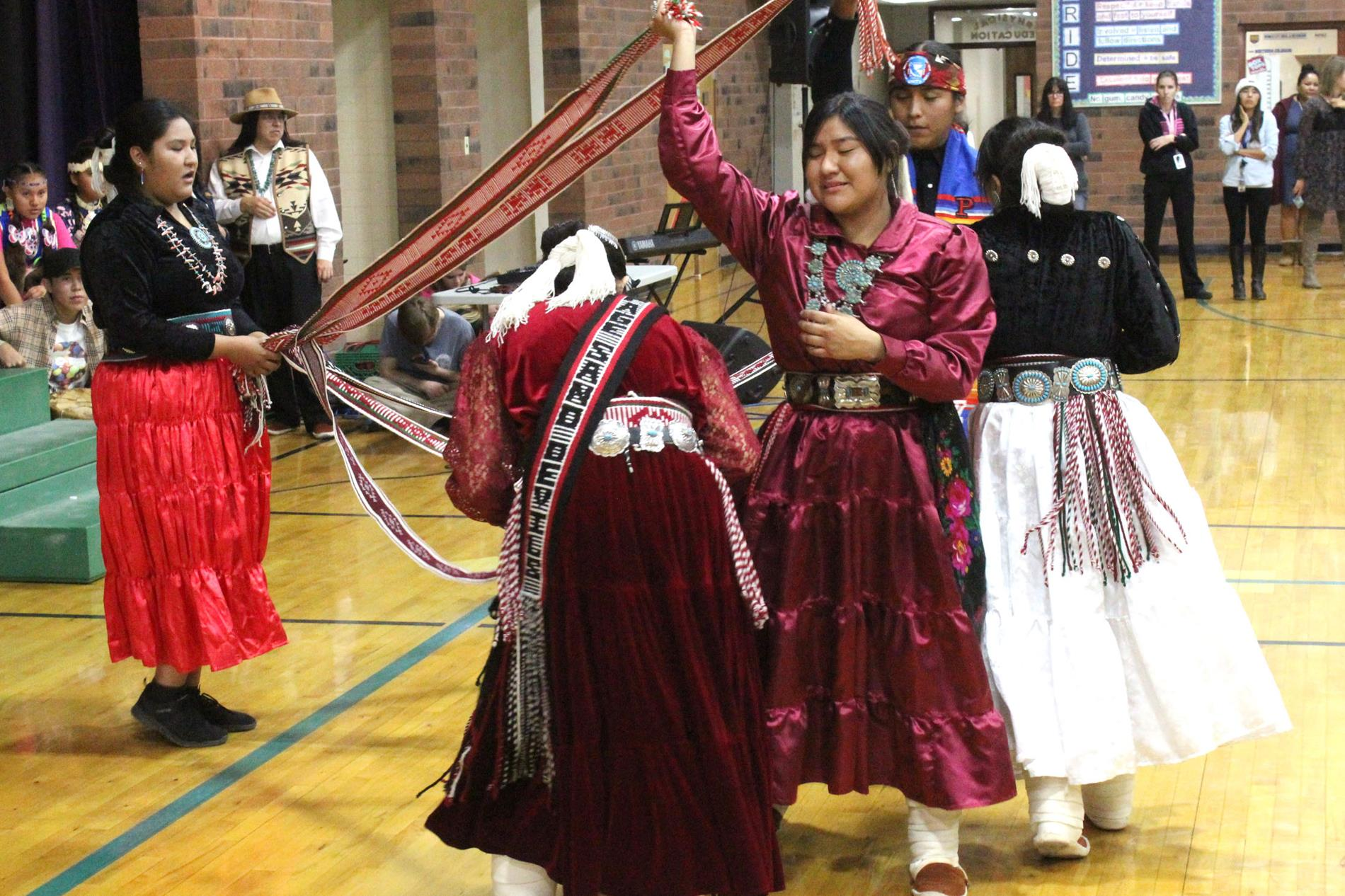 Navajo studenters performing a traditional dance.