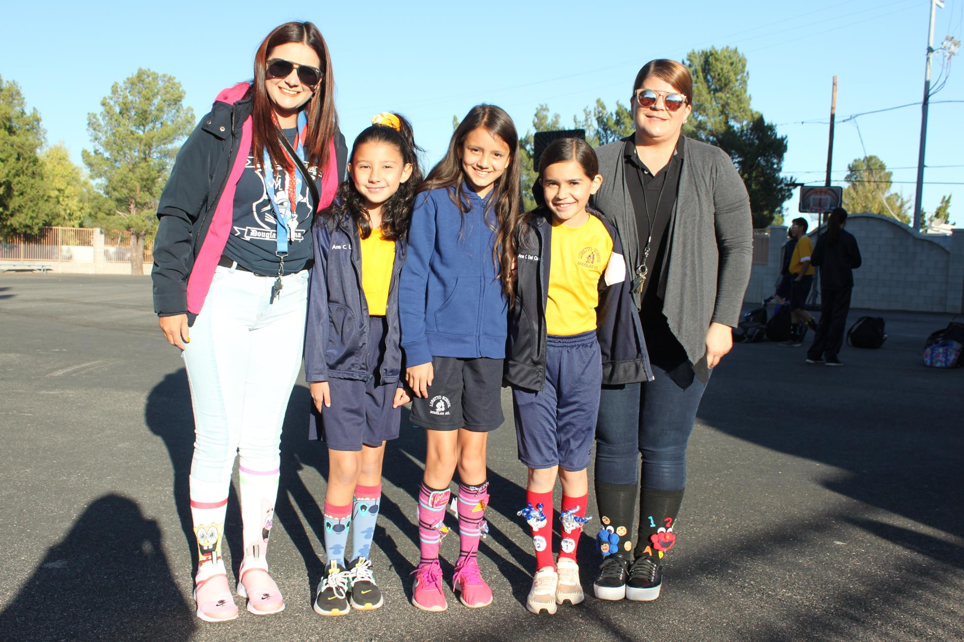 Students and staff with socks