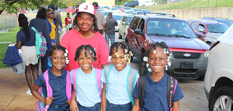 Ms. Fountain Henderson with kids during 1st day of school