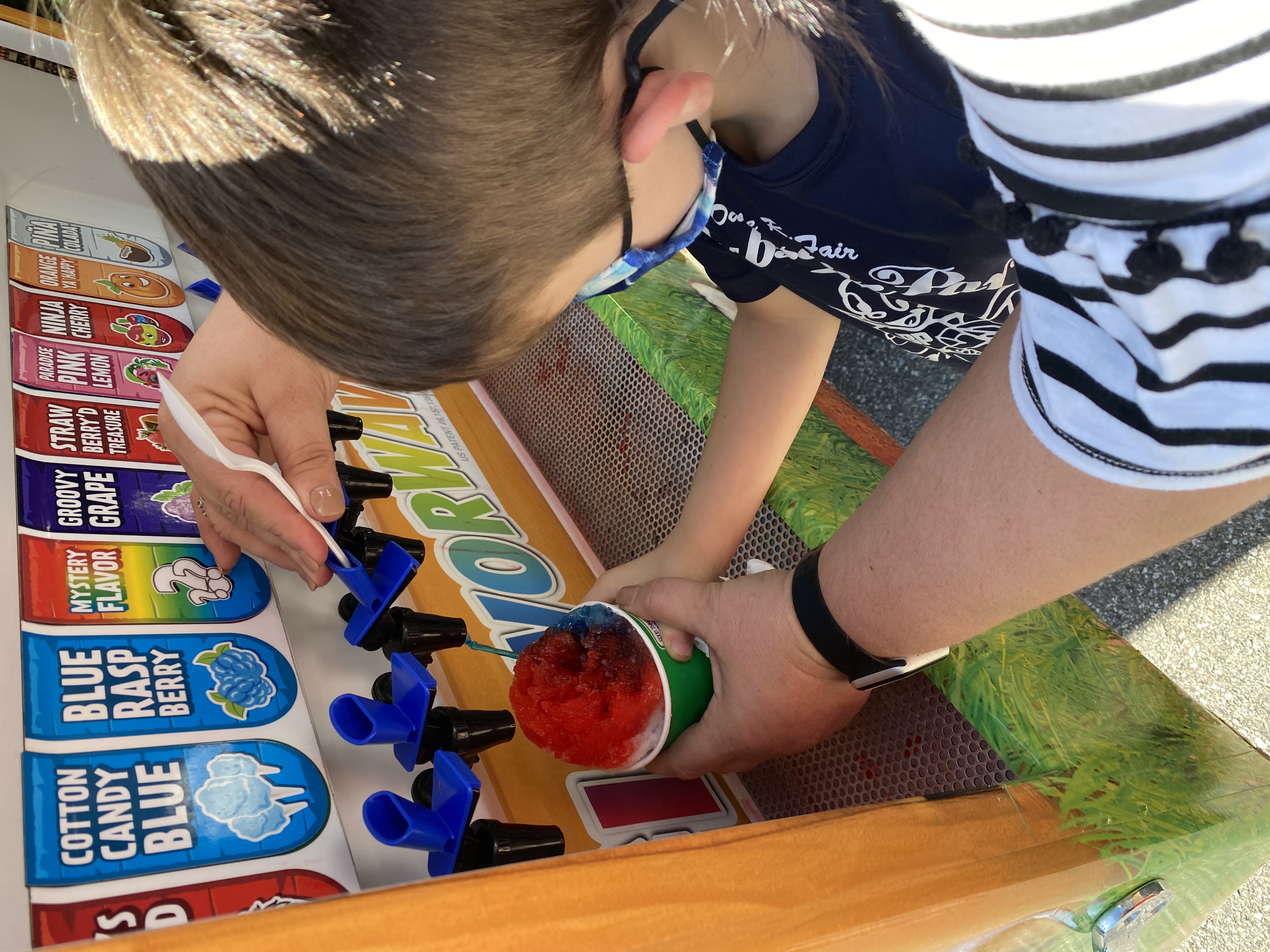 Adding flavoring to a Kona Ice