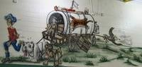 Picture of a conestoga wagon with all the county mascots