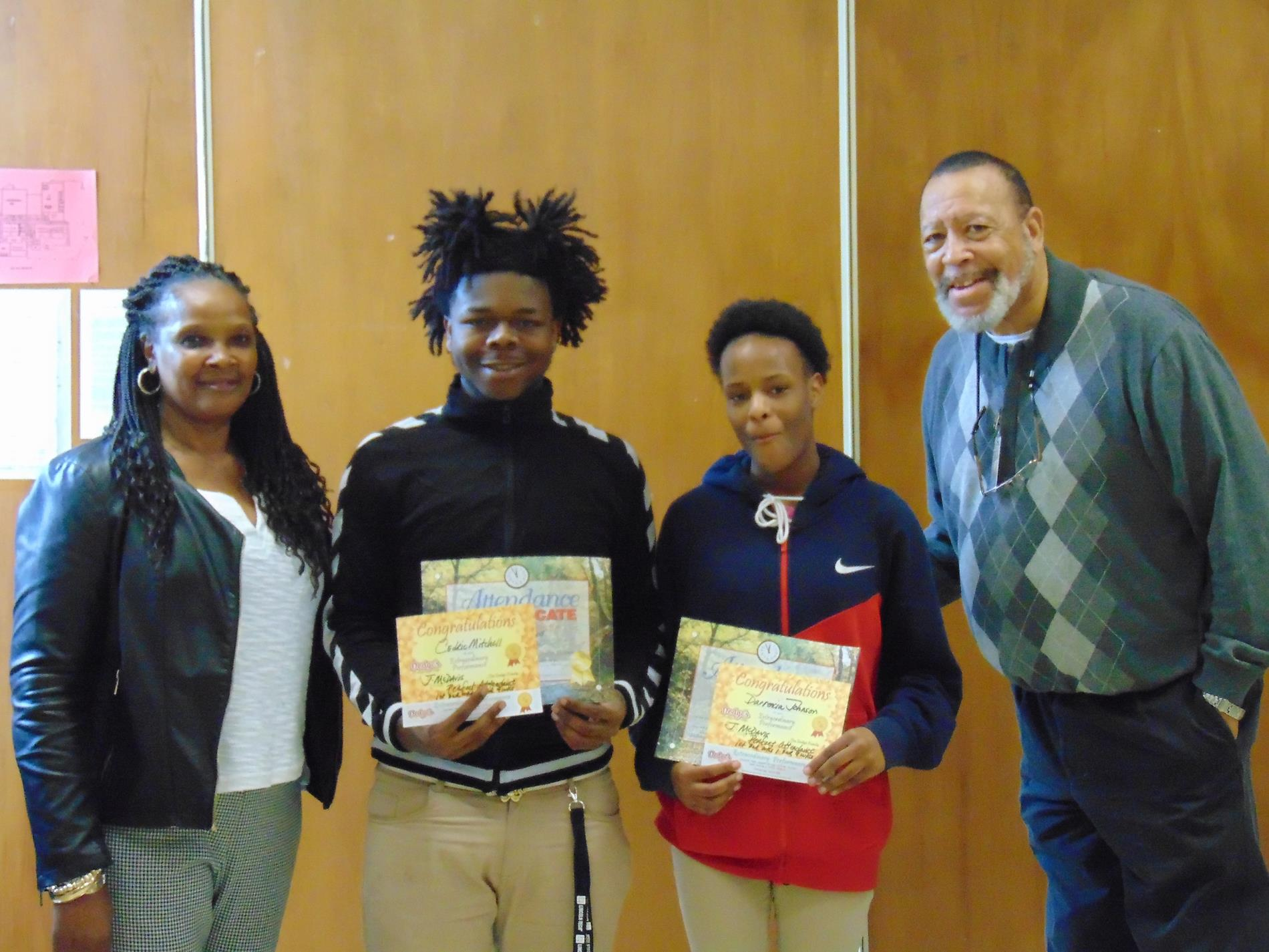 Cedric Mitchell and Darrencia Johnson receive improved attendance awards