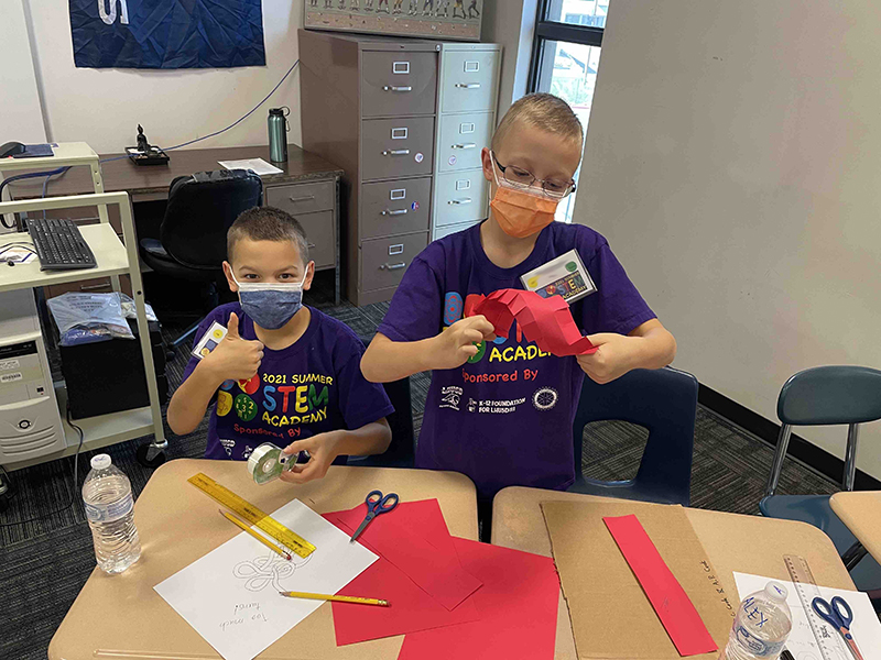 boys work on project during STEM Academy