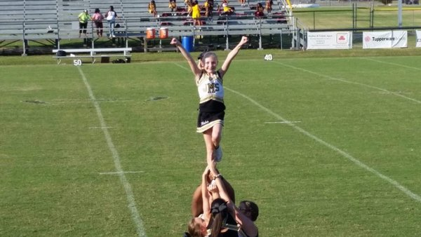 Cheerleader with arms up