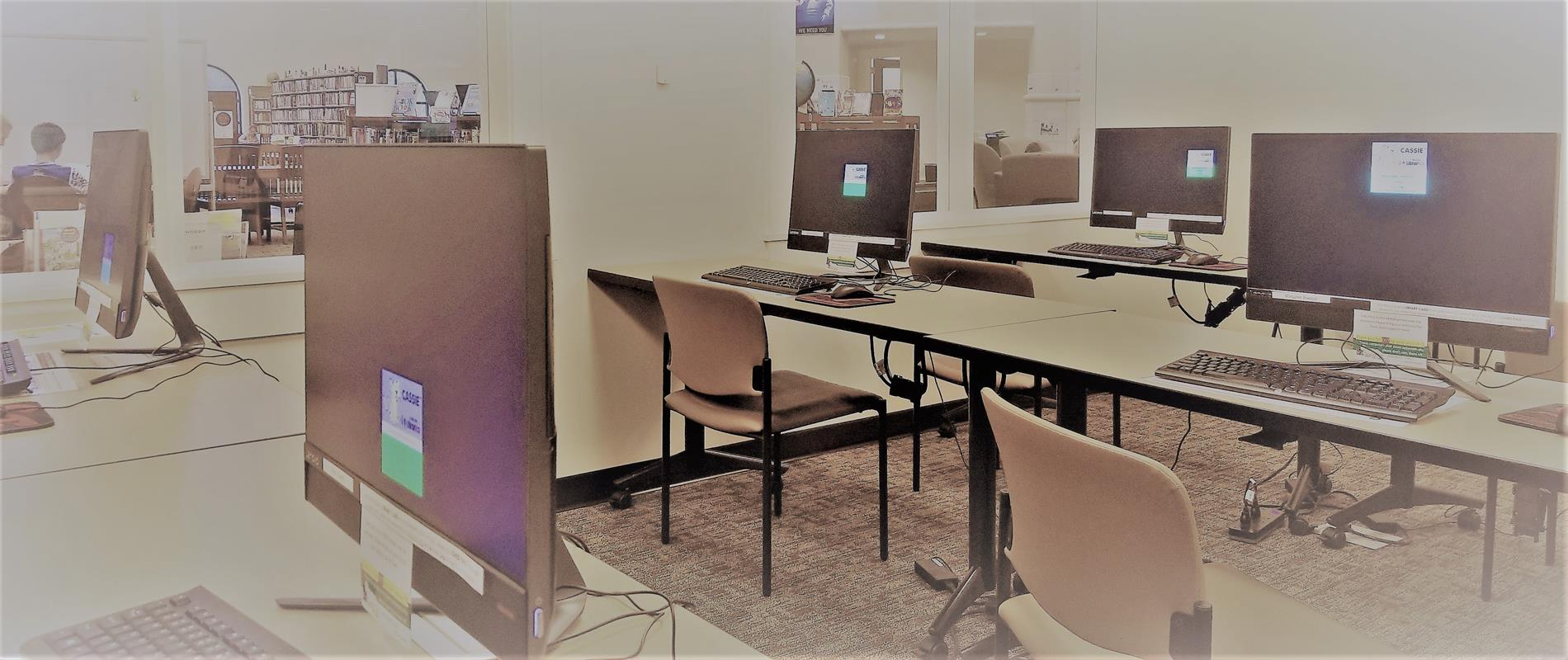 computers stations on tables in library