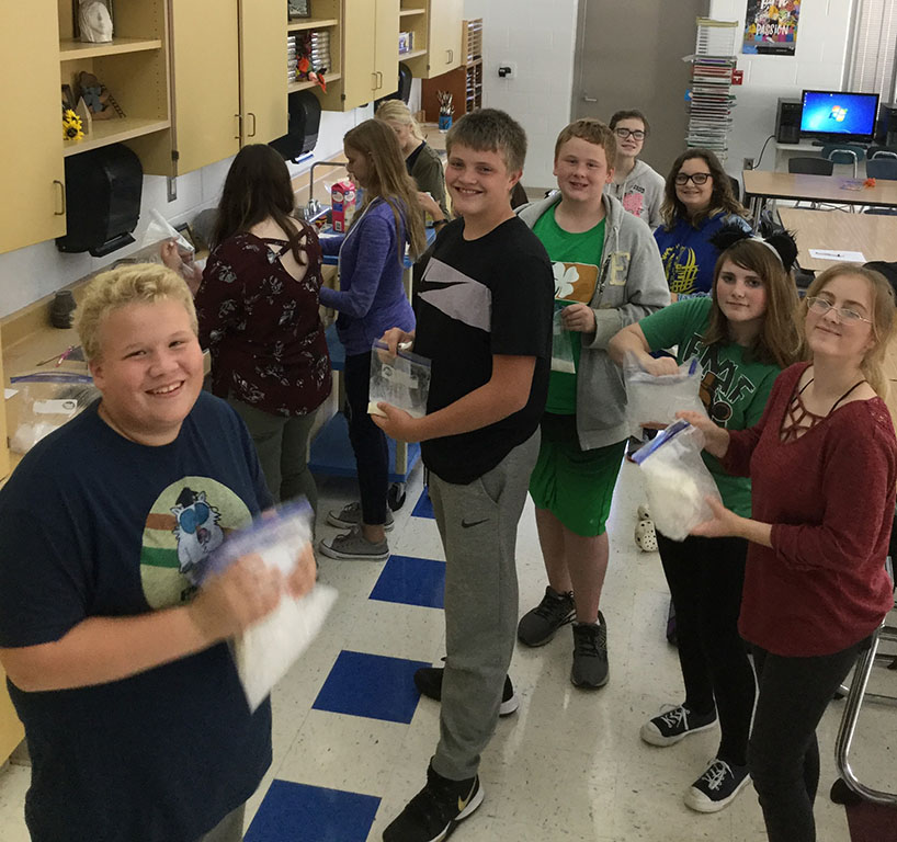 Art and Science Club making homemade ice cream.