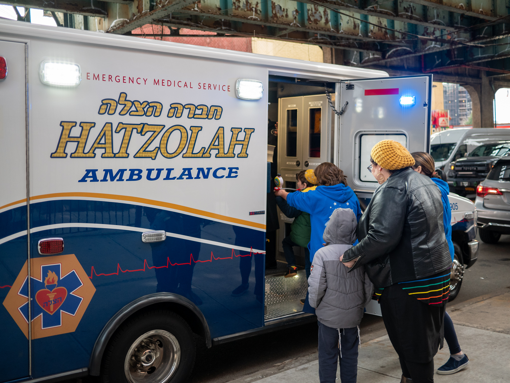 Students at Shema Kolainu - Hear our Voices explore the inside of a Hatzolah ambulance