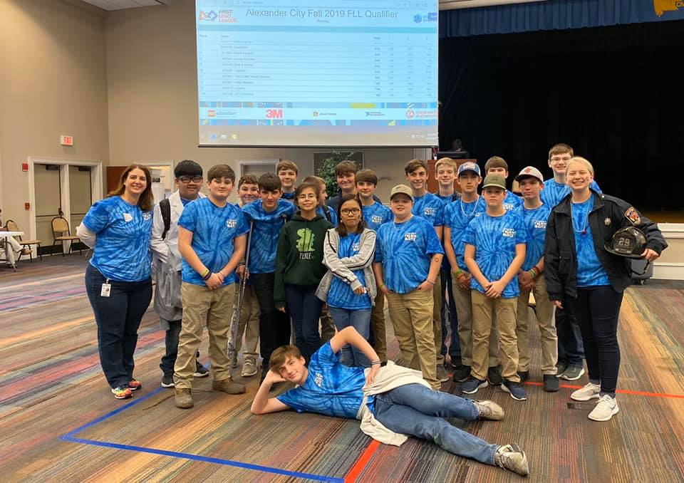 Causey robotics students with sponsor, Meredith Nations