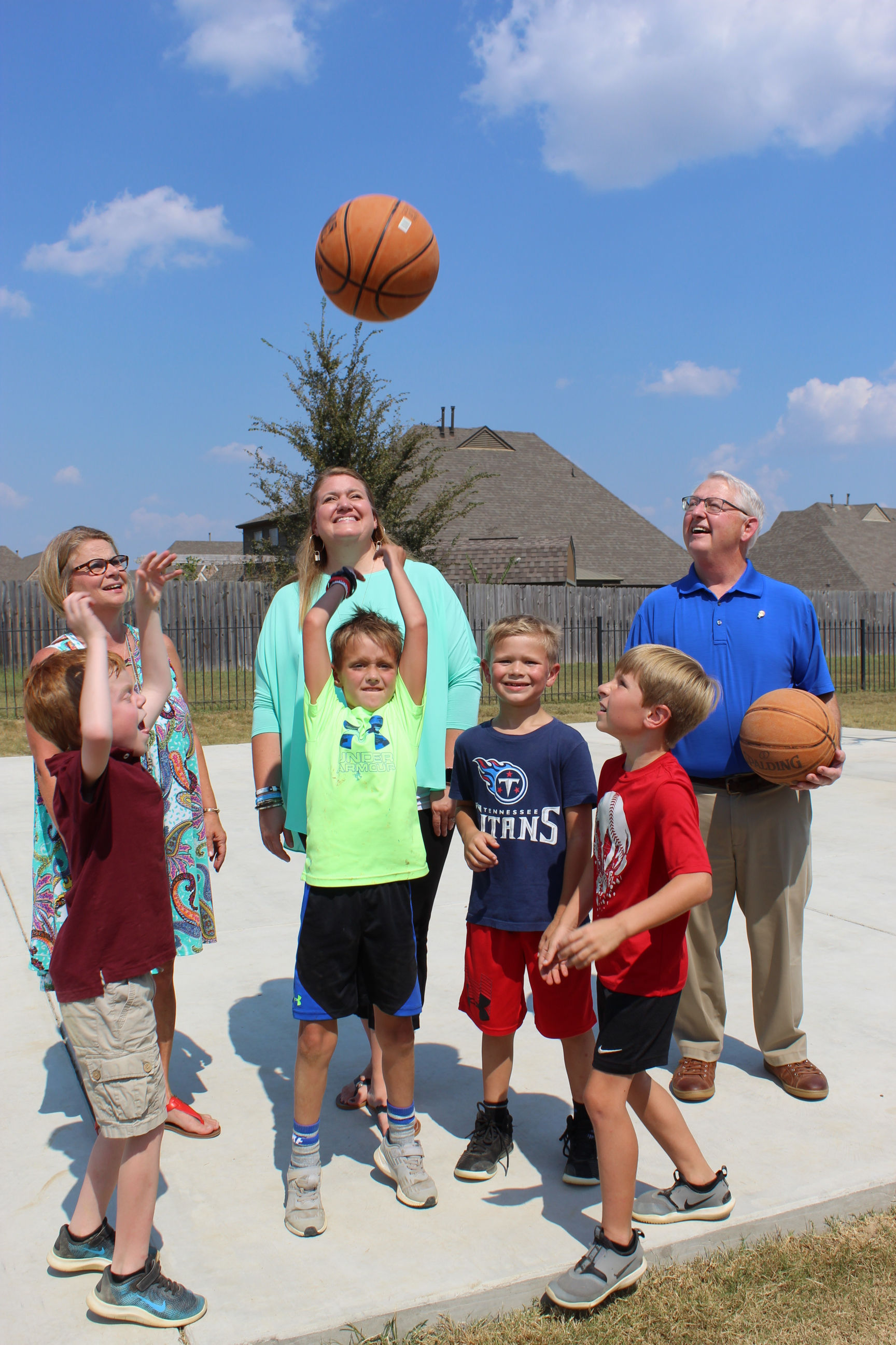 CHES Principal Leslie Heyman, Assistant Principal Kristy Hale, and Rotarian Dr. Greg Evans joined students on the new basketball court.