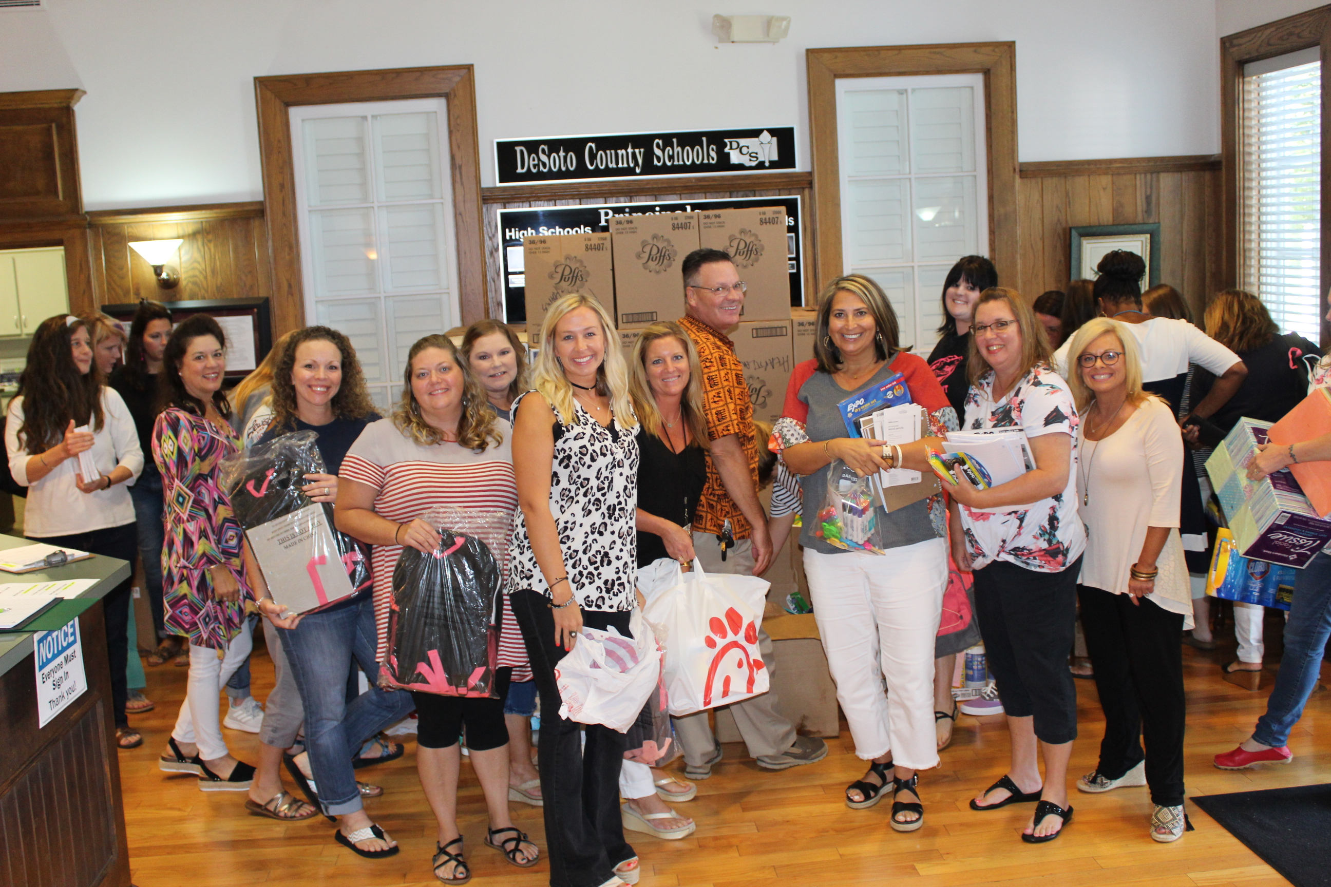 Teachers gathered school supplies that were donated by Chick-fil-A to take to their schools.