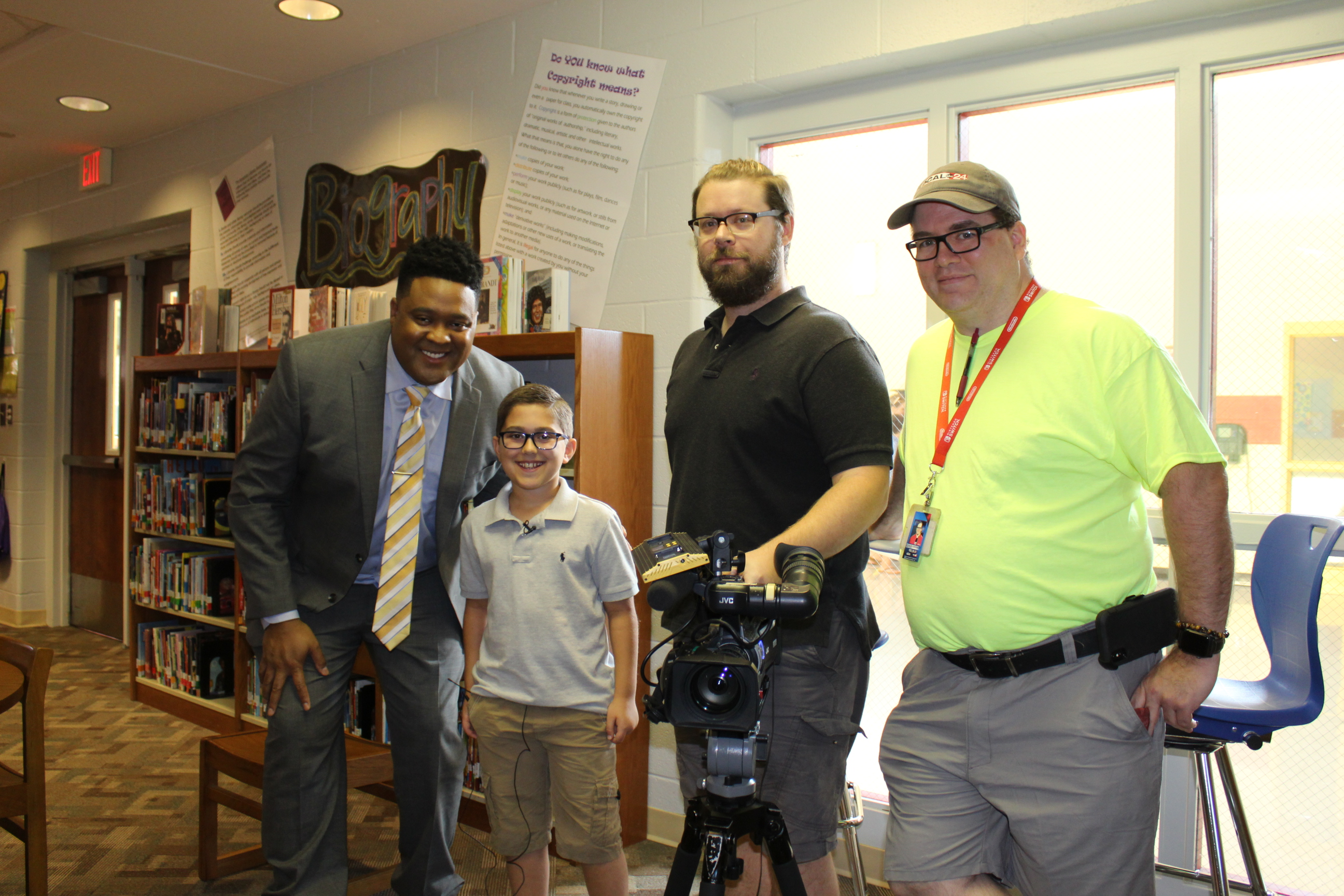 Local Cool Kid Gus Lafever is pictured with ABC News Anchor John Paul and his staff.