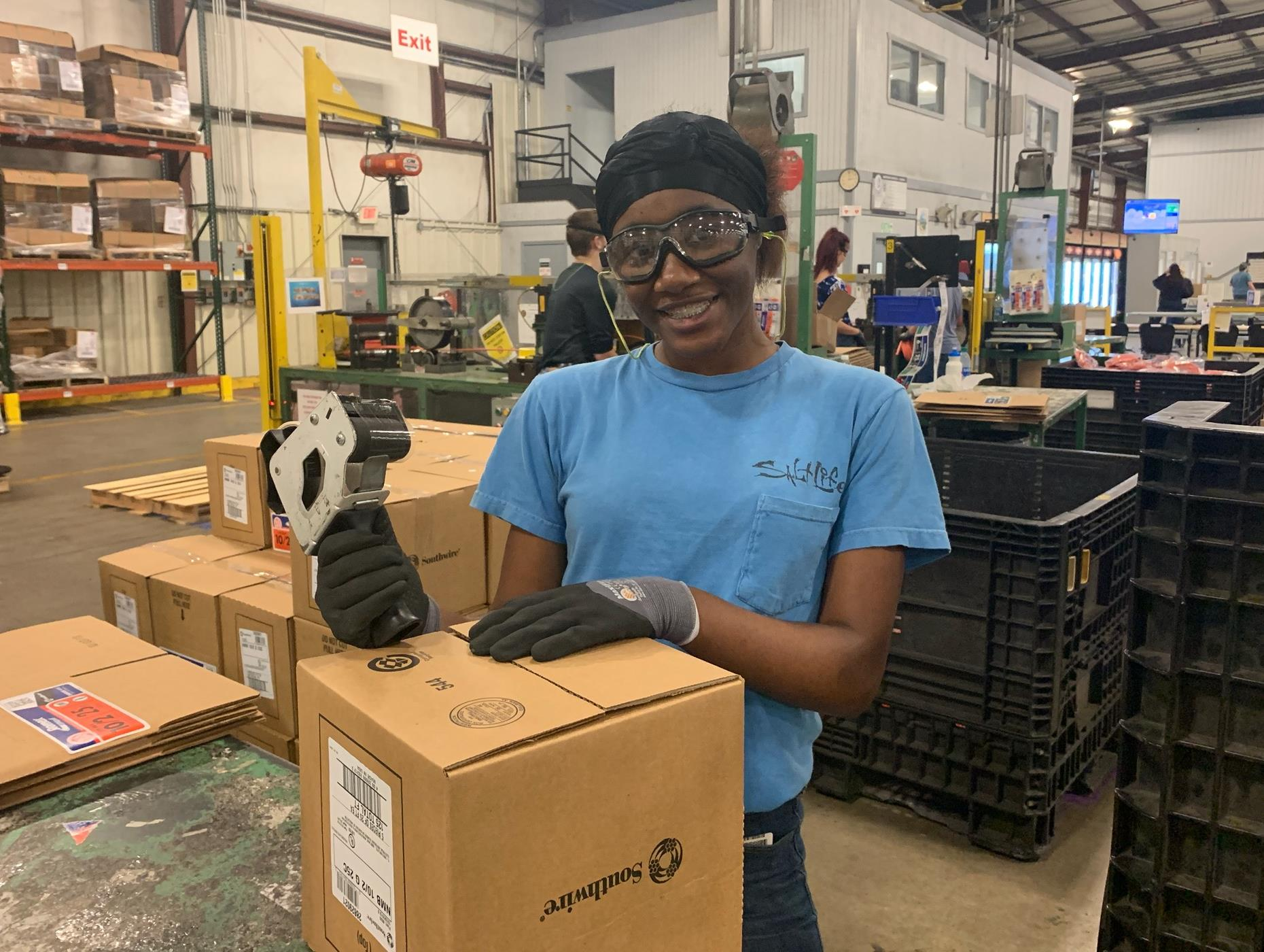 Student complete final packaging of product before shipment to customers