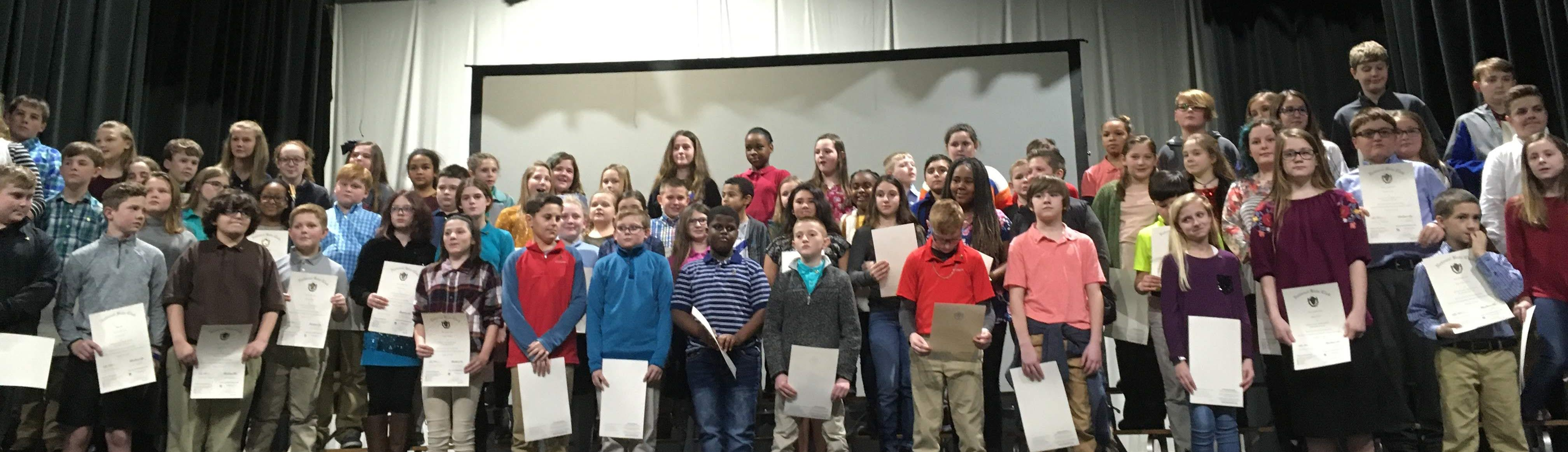 Students stand with Jr. Beta Certificates