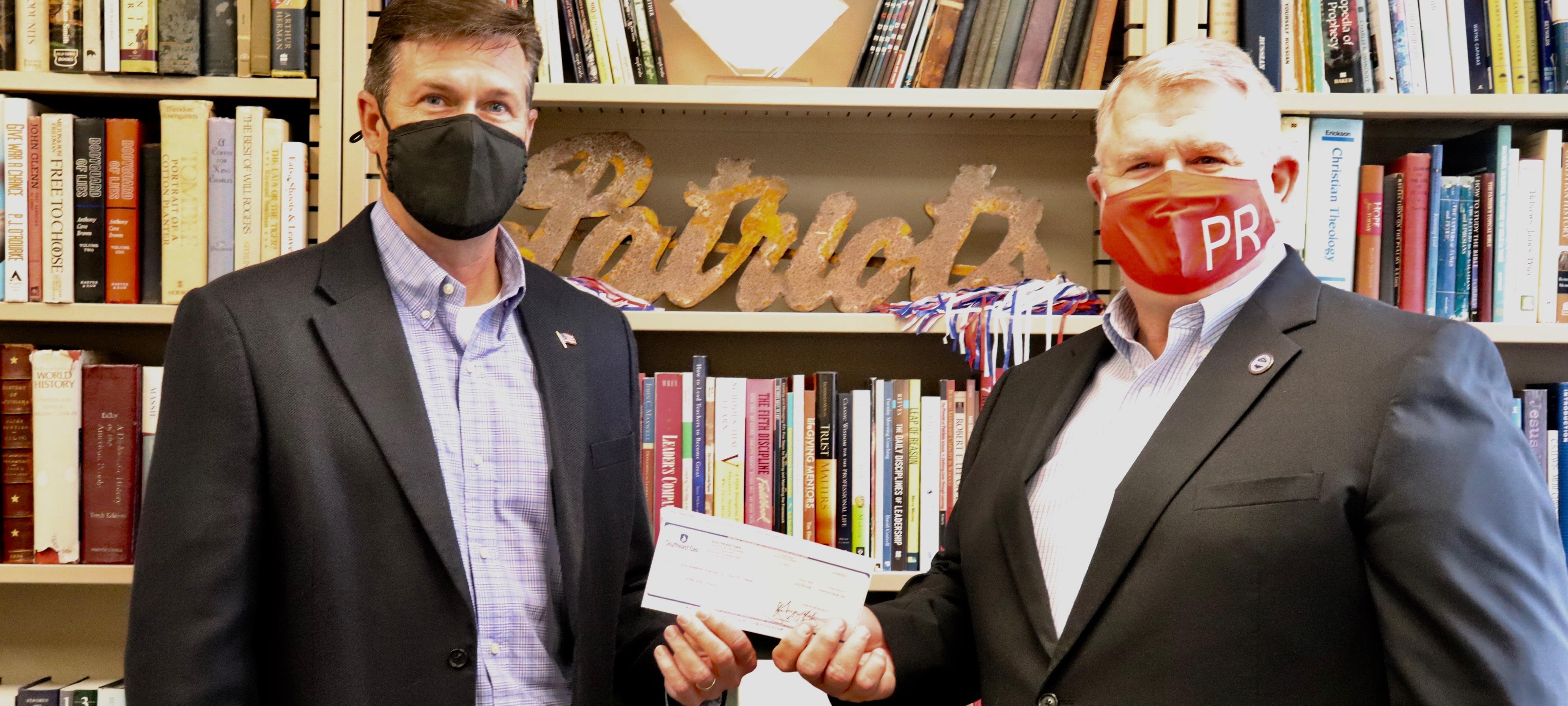 Southeast Gas Presents Check To Dr. Ledbetter