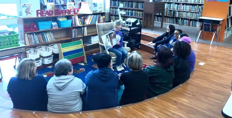 retiring library teacher reading to former students who are now teachers