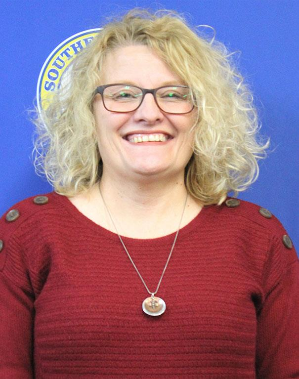 Mrs. P. Exline, School Board