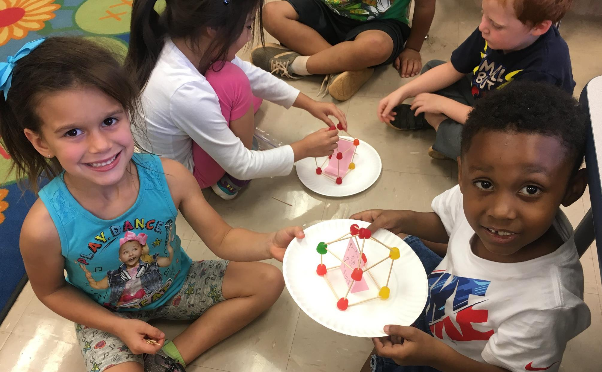 kindergarten students making models with gumdrops
