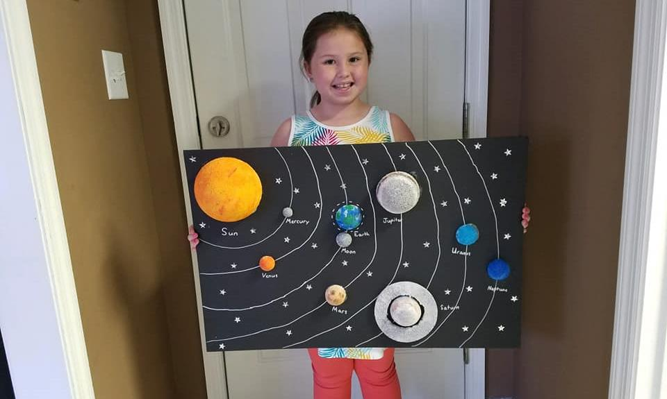 student showing solar system project