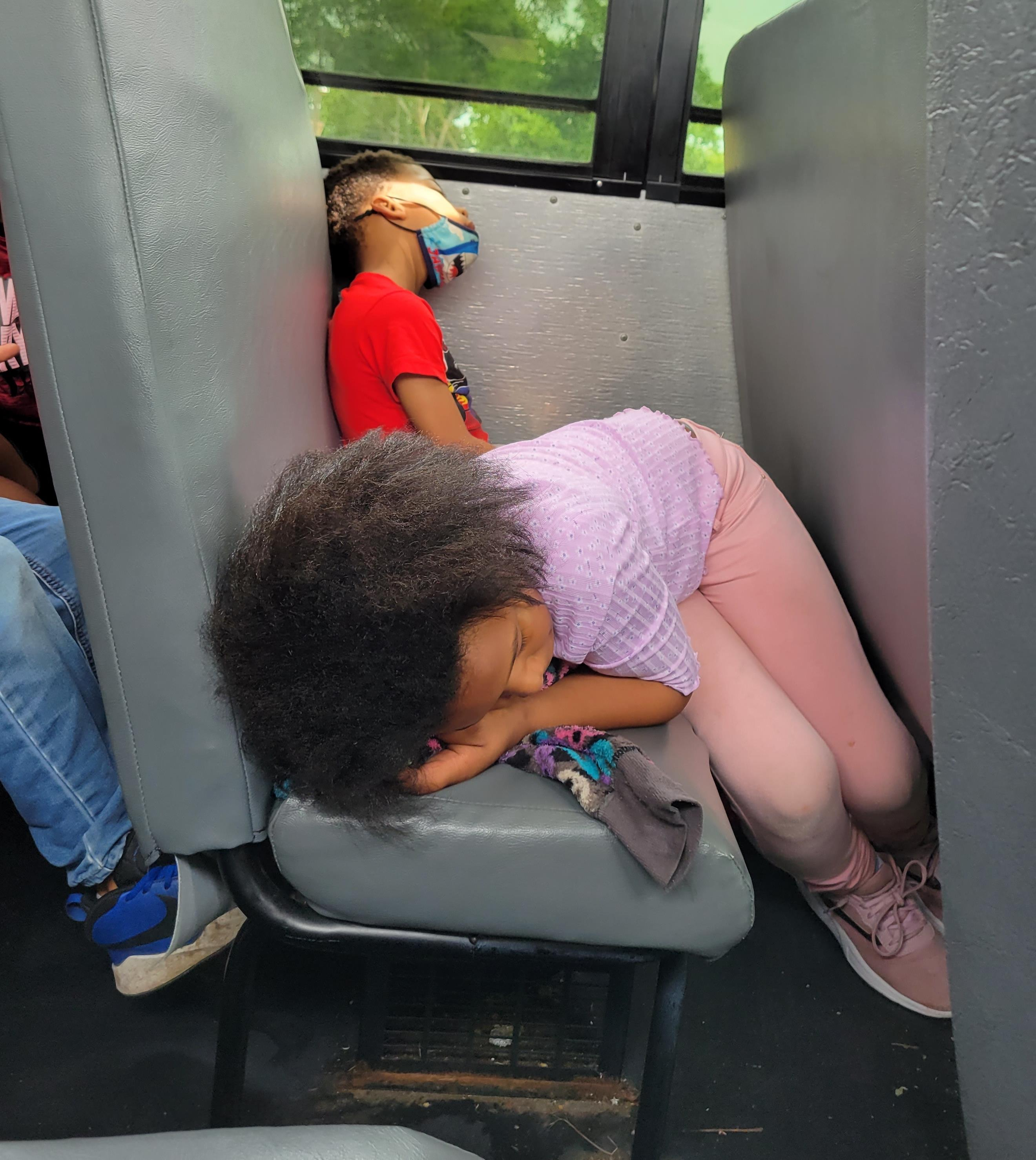 Students sleeping on the bus